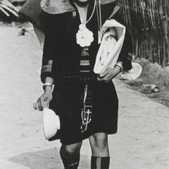 Akha woman returning home from marketing in Houa Khong Province