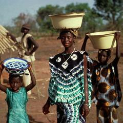 Woman and Two Children Transporting Goods to Market in Enamel Bowls