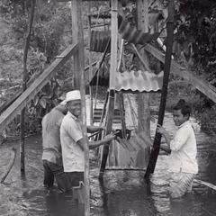 Construction of a waterwheel by villagers in the Houei Kong Cluster in Attapu Province
