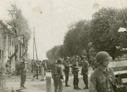 American soldiers standing around after the fighting