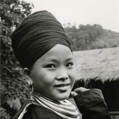 A Blue Hmong (Hmong Njua) woman poses in a Hmong village in the vicinity of Muang Vang Vieng in Vientiane Province