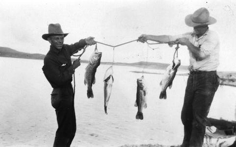 Displaying large-mouth bass, Roosevelt Lake, Arizona (other man not identified), August 1923