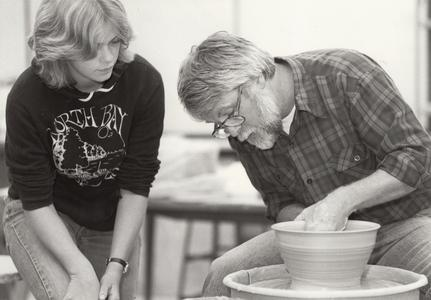 Pottery throwing instruction by James Zemba