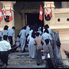 Vietnamese entering temple