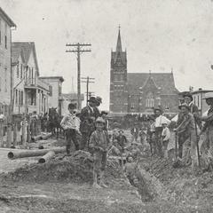 Installing water line, 1902