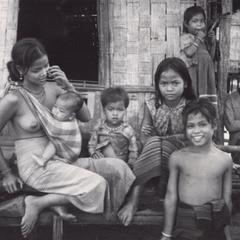 Nyaheun mother with baby and several children surrounding her in Houei Kong Cluster in Attapu Province