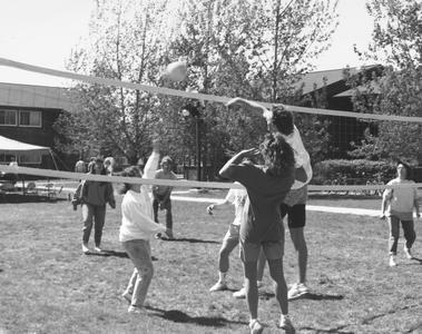 Students playing volleyball near student housing