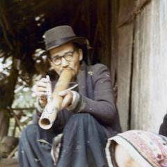 Blue Hmong man smoking water pipe in northern Thailand