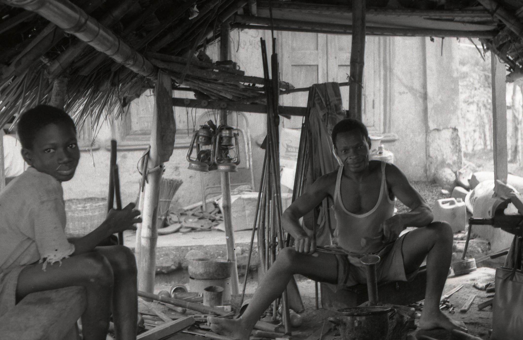 Blacksmith and helper at Oshu market