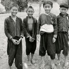 Five Blue Hmong (Hmong Njua) boys stand in a Hmong village near Muang Vang Vieng in Vientiane Province