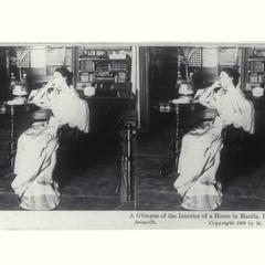 A young woman sitting at a desk, Manila, 1899