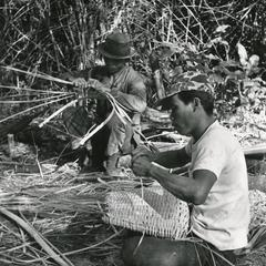 Villagers weaving bamboo to make fish baskets in Attapu Province