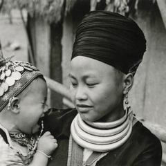 A Blue Hmong (Hmong Njua) woman with her child in a Hmong village in the vicinity of Muang Vang Vieng in Vientiane Province