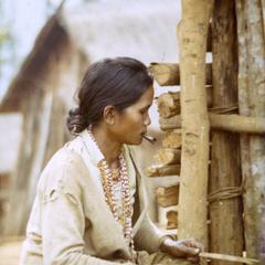 A Nyaheun woman smokes a homemade cigarette in Attapu Province