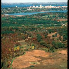 Aerial view of Greene Prairie, University of Wisconsin Arboretum, with Madison in background