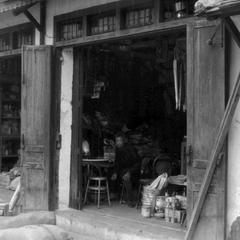 Chinese stores with sacks of rice, cooking oil, and pots
