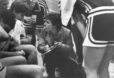Women's basketball players in a huddle