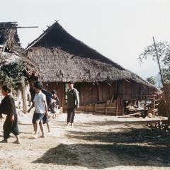 Yao (Iu Mien) youth walking in a village in Houa Khong Province