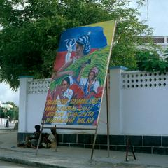 Political Billboard with Women and Flag