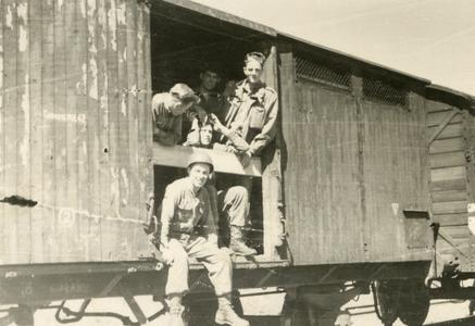 Ray Cunneen sitting in the doorway of the box car