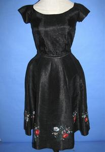 Two piece dress of black heavy synthetic woven material