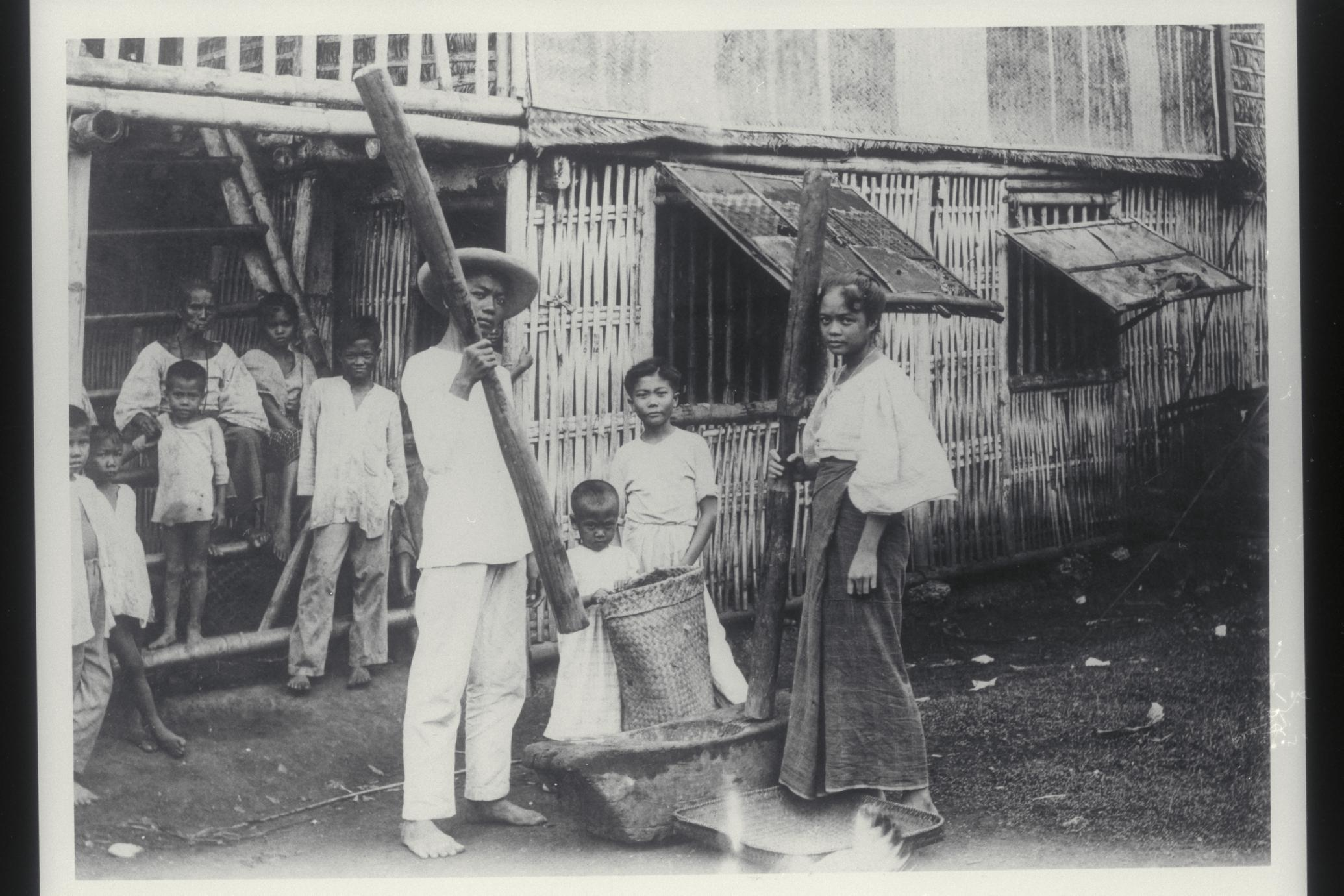 Shelling rice with hand implements, 1920s