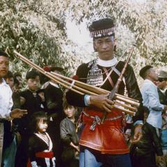 "A White Hmong man with ""qeej"" musical instrument in Houa Khong Province"