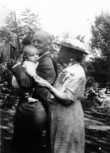 Aldo Leopold holding a baby