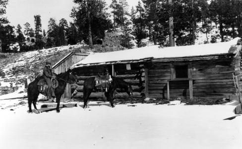 Aldo in front of cabin at abandoned Irwin claim, Apache National Forest, Arizona, 1910
