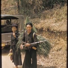 Hmong (Meo) with load of grass