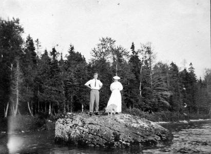Aldo and Clara Leopold standing on rock