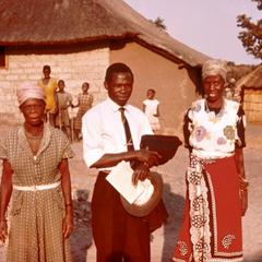 Reverend Musialela, His Wife and Mother Visiting in His Home Village