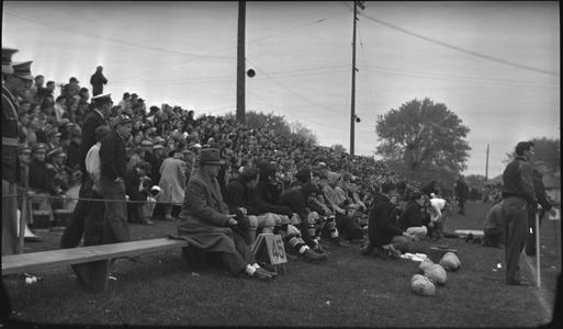 Coaches and fans at football game
