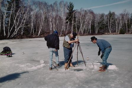 """Little John"" Cross, John Snow, and Jim Peterson construct a fish-spearing tipi"