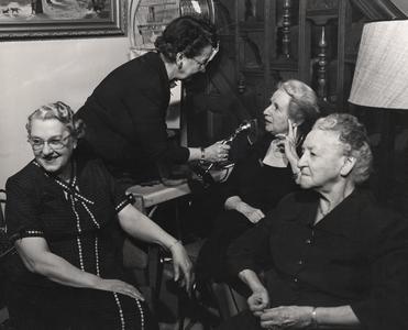 Aline Hazard interviews a group of women