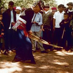 "White Hmong man playing Hmong ""qeej"" for Hmong New Year in Houa Khong Province"