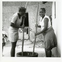 Women pounding yam