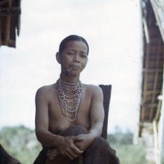 A Nyaheun woman smokes her tobacco pipe in Attapu Province