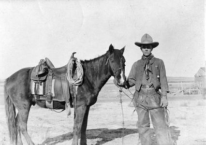 Standing with horse, Arizona, 1911