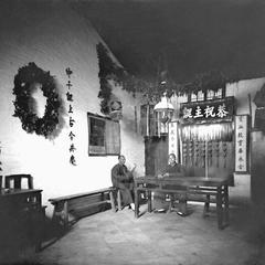 Doctor Patton and an elder, inside the old chapel at Yeungkong 陽江.