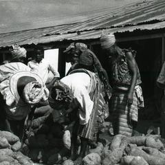 Mrs. Ogendengbe and co-sellers sorting yams at the market