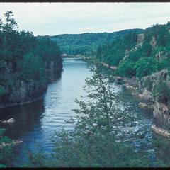 View of a river with cliffs in a northern forest