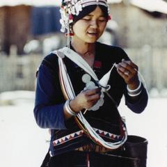 Akha woman spinning yarn in the village of Phate in Houa Khong Province
