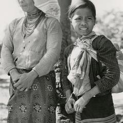 Nyaheun woman and young girl stand roadside in Attapu Province
