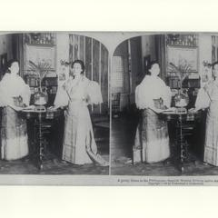 Young Spanish mestizo women in native dress inside a home, Manila, 1899