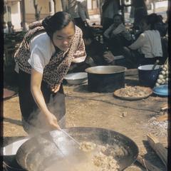 Woman stirring stew