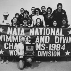 Women's swimming and diving team posing with NAIA Championship banner