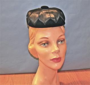 Black velvet pillbox-style hat