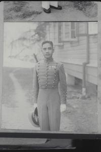 Cadet with cap in hand