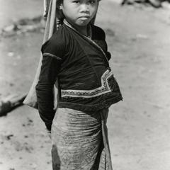 Khmu'-Khuen girl carries a shoulder bag on her forehead to carry items in Houa Khong Province